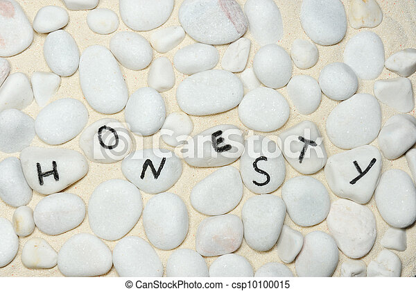 Honesty word on group of stones on the sand