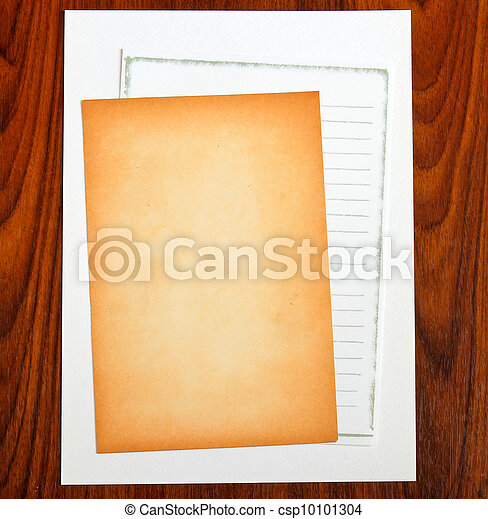 Blank notepaper on wooden background - csp10101304