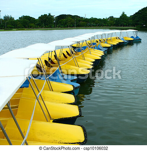 Yellow and  blue water-cycle boat in park  - csp10106032