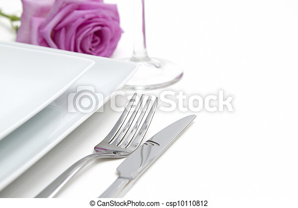 Dinner place setting. white china plates with silver fork and knife - csp10110812