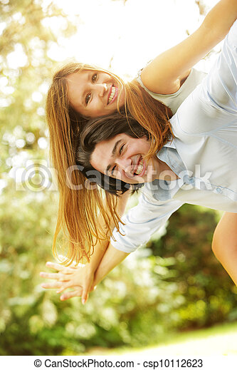 Young happy couple in the park - csp10112623