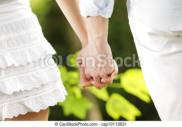 holding hands in a park - csp10112631