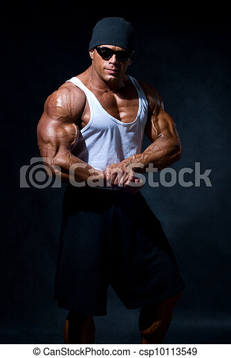 strong athletic man in dark glasses - csp10113549
