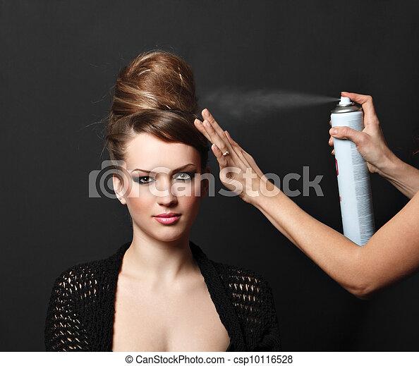 Hair spray, woman over black - csp10116528