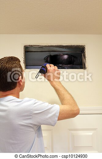 Man Looking into Air Duct - csp10124930