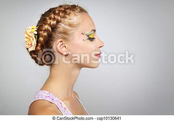 Woman with beautiful hairstyle and creative make-up - csp10130641