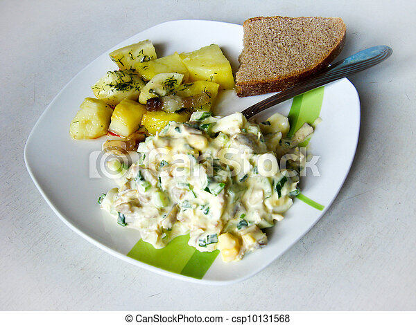 Dish from a potato and salad - csp10131568