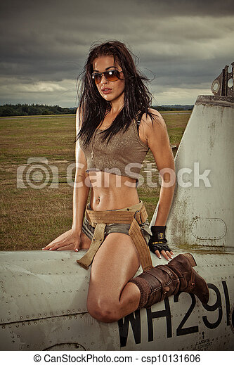Sexy woman astride aircraft fuselage - csp10131606