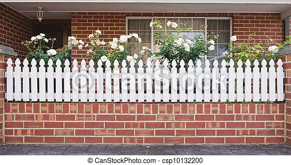 beautiful house entrance with white fence and small front yard