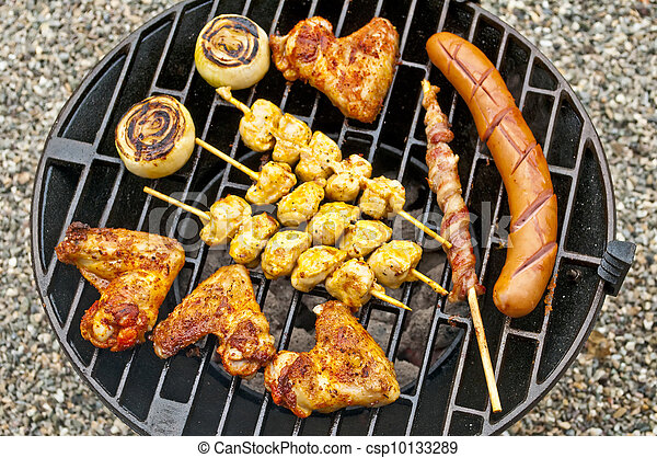 barbecue with chicken wings, Bratwurst, meat skewer and ham - csp10133289