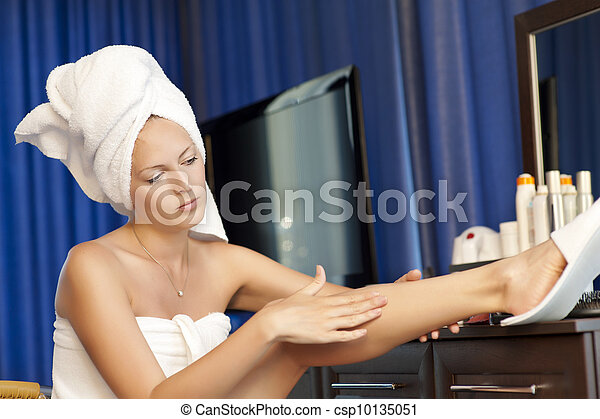 Young woman applying moisturizer cream - csp10135051