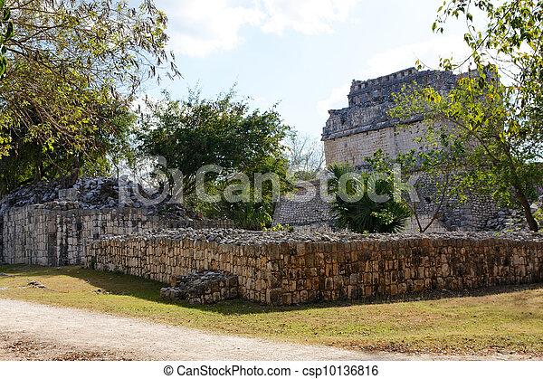 Mayan Ruins among Vegetation at Chichen Itza - csp10136816