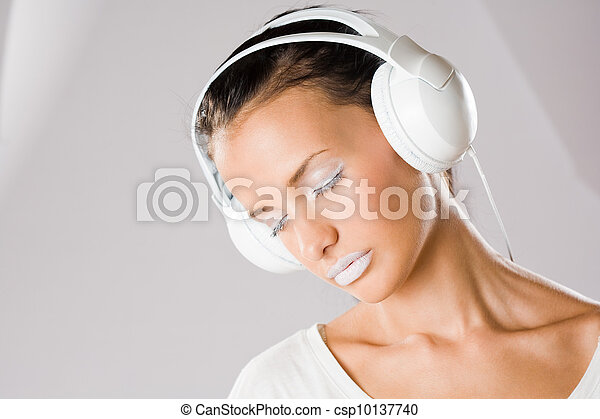 Dreamy young music lover. - csp10137740