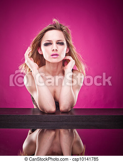 Pretty woman in a bra reflected in mirror - csp10141785
