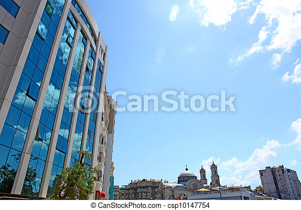 Contrast between traditional ottoman style old mosque and modern business buildings in Istanbul, Turkey. - csp10147754