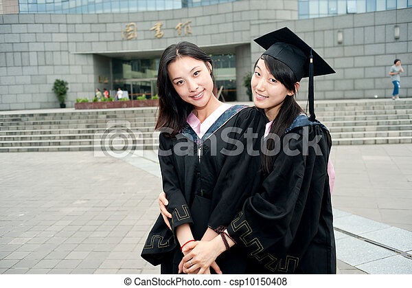 Two female student wearing a Bachelor of clothing - csp10150408