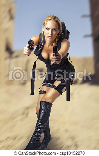 woman holding two hand gun - csp10152270