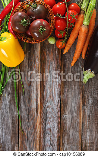 Vegetables still life in wooden background - csp10156089