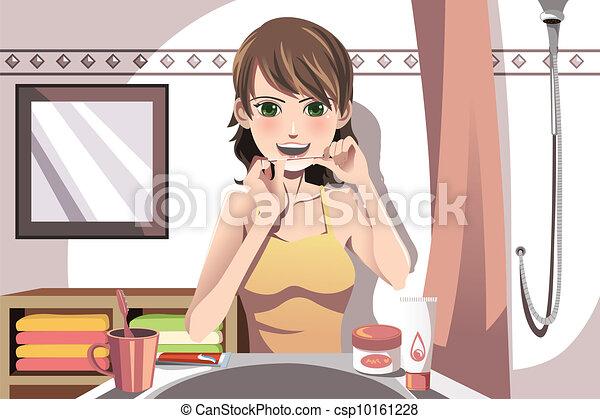 Woman flossing her teeth - csp10161228