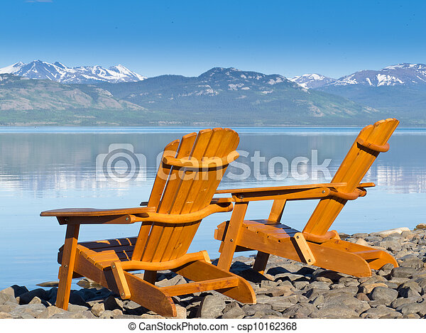 Wooden deckchairs overlooking scenic Lake Laberge - csp10162368