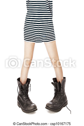 old leather military boots, striped singlet on woman feet - csp10167175