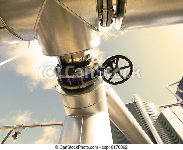 Industrial zone, Steel pipelines and valves against blue sky - csp10170062