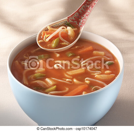 Hot and sour chinese soup in a white bowl - csp10174047