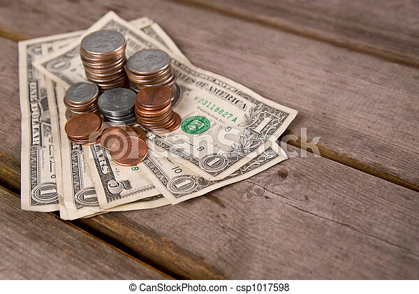Pictures Of Coins And Money On A Picnic Table Csp1017598