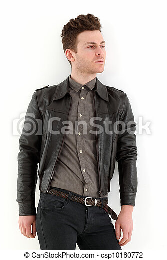 Young adult man posing with leather jacket - csp10180772