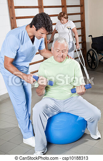 Physical Therapist helping a Patient - csp10188313