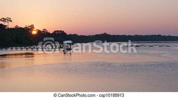 Sunrise over a river in the low country of South Carolina. - csp10188913