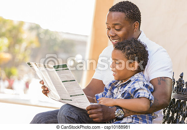 Mixed Race Father and Son Reading Park Brochure Outside - csp10188981
