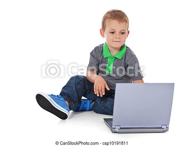 Boy using computer - csp10191811