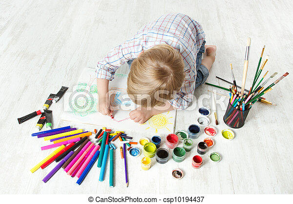 Child drawing picture with crayon  in album using a lot of painting tools. Top view. Creativity concept. - csp10194437