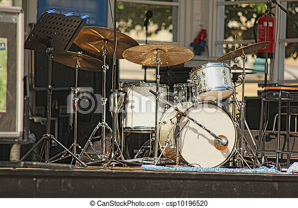 Drumset with nobody on stage, outdoors, isolated - csp10196520