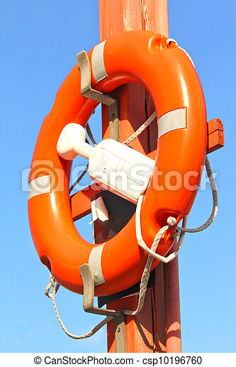 Life buoy attached to a pole towards blue sky - csp10196760