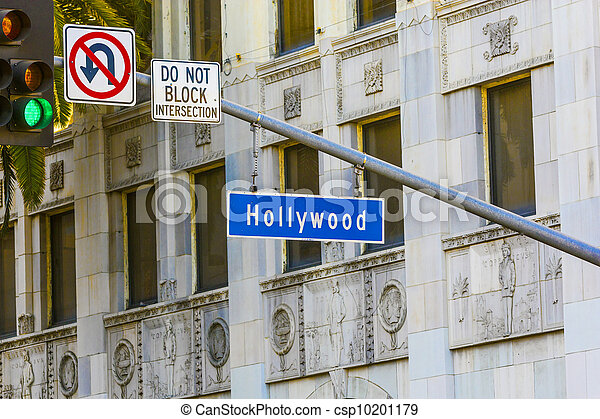 Hollywood Blvd street sign with tall palm trees. - csp10201179