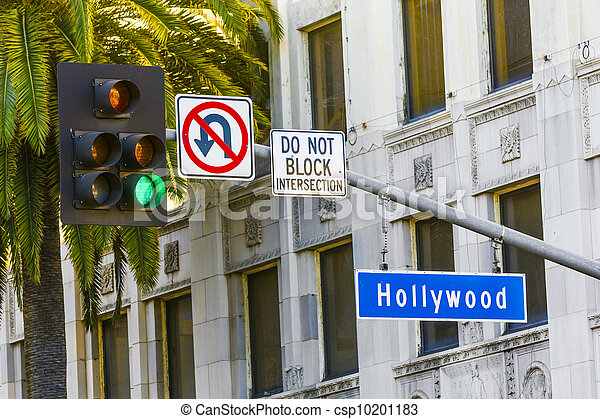 Hollywood Blvd street sign with tall palm trees.  - csp10201183