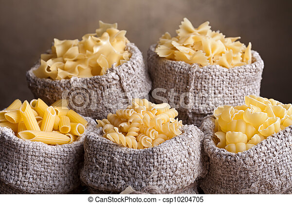 Pasta assortment in burlap bags - csp10204705