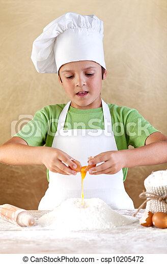 Boy with chef hat preparing the dough - csp10205472
