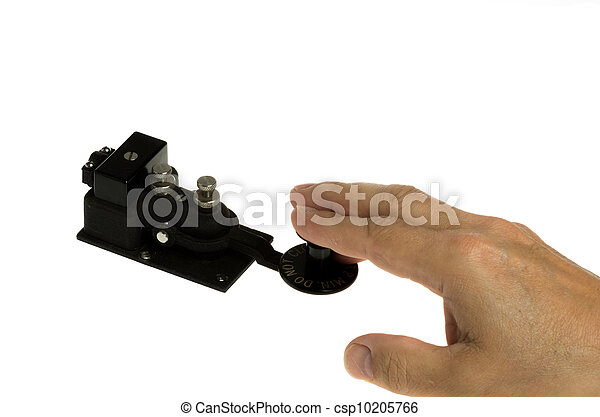 Telegraph key and hand isolated on white - csp10205766