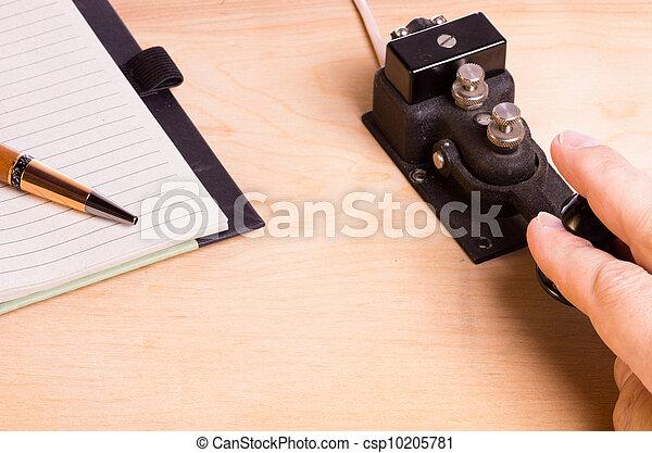 Telegraph key and notebook - csp10205781