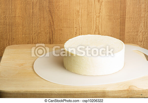Round block of white cheddar cheese - csp10206322