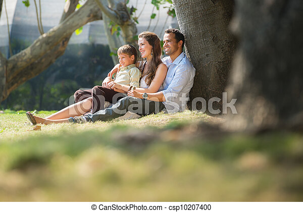 Happy family in city gardens relaxing during holidays - csp10207400