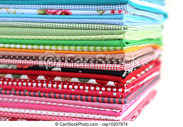 Pile of colorful cotton textile  background - csp10207974