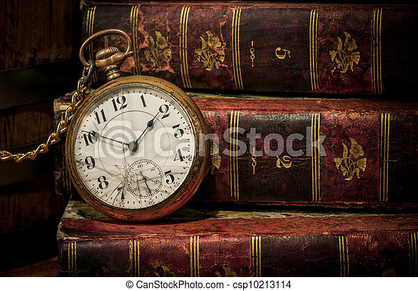Old pocket watch and books in Low-key copy space - csp10213114