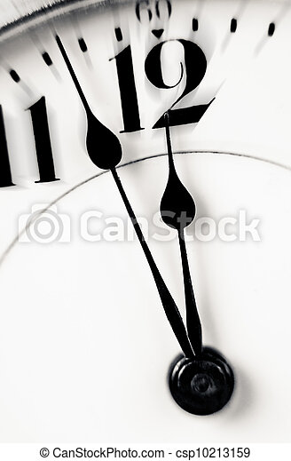 Clock hands almost twelve zoom in - csp10213159