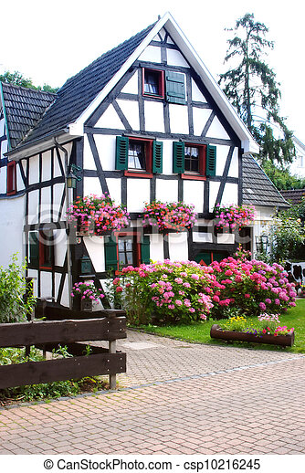 Stock photo of half timbered house with flower garden for Half timbered house plans