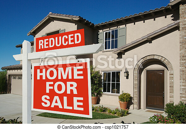 Reduced Home For Sale Sign in Front of New House - csp1021757