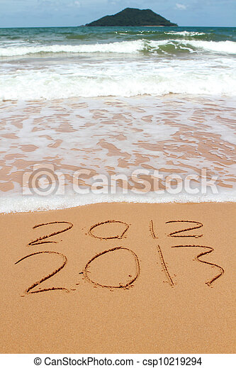 2013 year on the sand beach near the ocean. 2012 is been erasing by wave - csp10219294